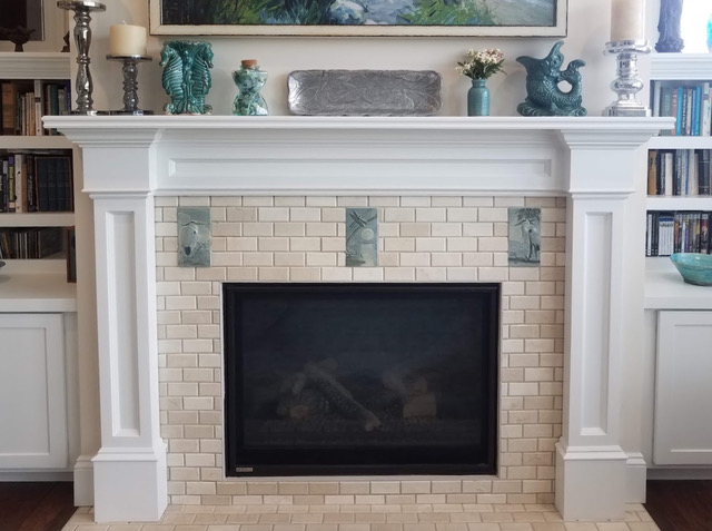 Herron tiles over fireplace mantel